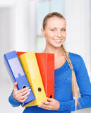 Young attractive businesswoman with folders Royalty Free Stock Photo