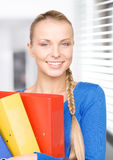 Young attractive businesswoman with folders Stock Photography