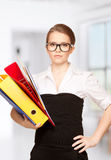Young attractive businesswoman with folders Stock Photo
