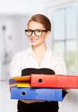 Young attractive businesswoman with folders Royalty Free Stock Photography