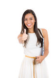 Young attractive businesswoman giving thumbs up Royalty Free Stock Photos