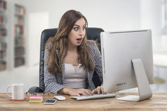 Young attractive businesswoman with a happy expression at office Royalty Free Stock Images