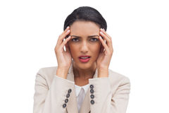Young attractive businesswoman having a headache Royalty Free Stock Photography