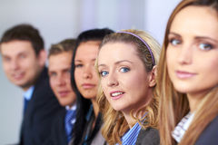 Young attractive businesswoman and her team Stock Photography