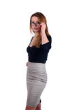 Young attractive businesswoman holding glasses Royalty Free Stock Photos