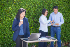 Young attractive businesswoman with the notebook in the garden Stock Image