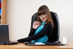 Young attractive businesswoman in office Royalty Free Stock Photo