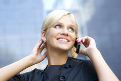 Young and attractive businesswoman with a phone Royalty Free Stock Images