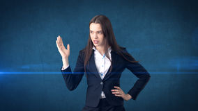 Young attractive businesswoman portrait in suit with standing and hand up, isolated studio background with copyspace. Stock Image