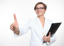 Young attractive businesswoman pressing the touchscreen button. Stock Photography