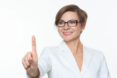 Young attractive businesswoman pressing the touchscreen button. Stock Photos