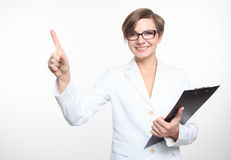 Young attractive businesswoman pressing the touchscreen button. Royalty Free Stock Photo