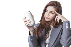 Young attractive businesswoman shop round a can of soft drink Royalty Free Stock Photography