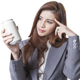 Young attractive businesswoman shop round a can of soft drink Stock Images