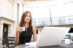 Businesswoman with laptop in cafe. Royalty Free Stock Images