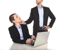 Young attractive businesswoman suffering sexual harassment and abuse of colleague or office boss Stock Image
