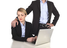 Young attractive businesswoman suffering sexual harassment and abuse of colleague or office boss Stock Photos