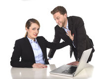 Young attractive businesswoman suffering sexual harassment and abuse of colleague or office boss Stock Photo