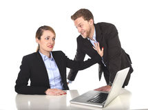 Young attractive businesswoman suffering sexual harassment and abuse of colleague or office boss Stock Images