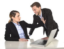 Young attractive businesswoman suffering sexual harassment and abuse of colleague or office boss Royalty Free Stock Photo