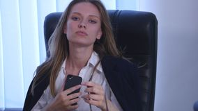 Young attractive businesswoman talking on telephone in the office stock video footage