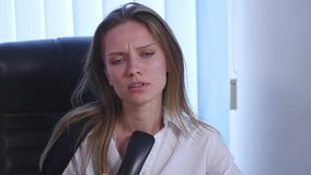 Young attractive businesswoman talking on telephone in the office and And drives out of the office. close up stock video footage