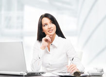 Young and attractive businesswoman working in office Stock Image