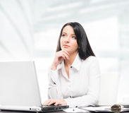 Young and attractive businesswoman working in office Royalty Free Stock Images