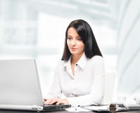 Young and attractive businesswoman working in office Royalty Free Stock Photos
