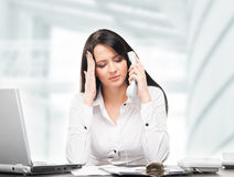 Young and attractive businesswoman working in office isolated Royalty Free Stock Image