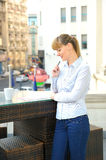 Young attractive businesswoman working in a restaurant terrace. Royalty Free Stock Photo