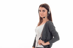 Young attractive call office girl with headphones isolated on white background in studio Stock Photography