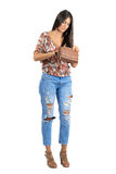 Young attractive casual beauty searching for something lost in her handbag royalty free stock photo