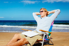 Young Attractive Casual Business Man Relaxing at the Beach with Stock Photography