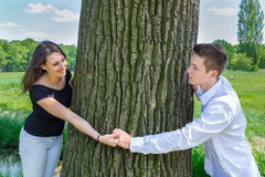 Young attractive caucasian couple in love holding hands around t Stock Image