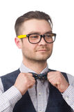 Young attractive  caucasian guy adjusts his bow tie isoalated on white Stock Photography