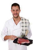 Young attractive caucasian male cook, t-bone steak Stock Images