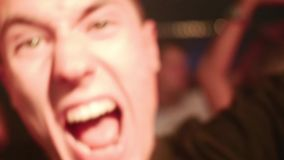 Young attractive caucasian male dancing in a club stock footage