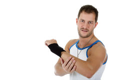 Young attractive caucasian man athlete, bandaged. Young attractive caucasian man athlete wearing a wrist brace, bandaged. White background. Studio shot royalty free stock images