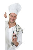Young attractive caucasian man chef, cake Royalty Free Stock Image