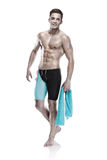 Young attractive caucasian man swimmer with goggles and towel Stock Photography