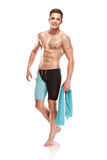Young attractive caucasian man swimmer with goggles and towel. Isolated over white background royalty free stock photos