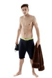 Young attractive caucasian man swimmer with goggles and towel is Royalty Free Stock Image