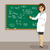 Young attractive caucasian math teacher standing next to blackboard Stock Photos