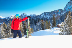 Young attractive caucasian skier with ski on ski slope against m. Ountain Stock Photos