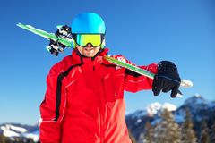 Young attractive caucasian skier with ski in Swiss Alps ready for skiing royalty free stock photo