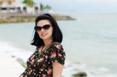 Young attractive caucausian  woman enjoys sun on ocean resort du Stock Photography