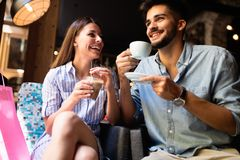 Young attractive couple on date in coffee shop stock photos