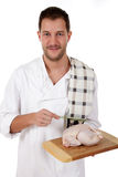 Young attractive chef caucasian male, chicken Stock Photo