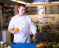 The Chef prepares food stock photo